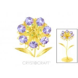 Zieds ar violetiem SWAROVSKI kristāliem, uz pamatnes, zelta pārklājums. Izmērs 6x6x13 cm.