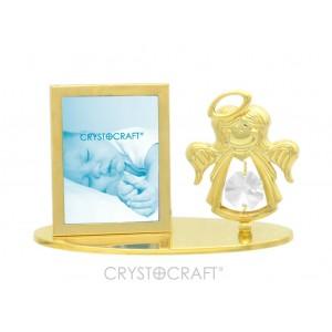 Apzeltīts fotorāmītis ar enģelīti, uz pamatnes, ar SWAROVSKI kristāliem, zelta pārklājums. Izmērs 10 x 4,5 x 6,5 cm.