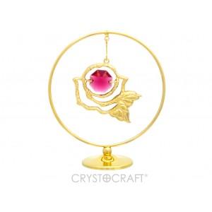 Rozīte iekārta ķēdītē aplī, ar SWAROVSKI kristāliem, uz pamatnes, zelta pārklājums. Izmērs 5 x 7 cm.