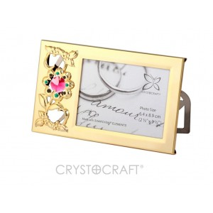 Foto-rāmītis ar SWAROVSKI kristāliem, zelta pārklājums. Izmērs 14 x 8 cm.