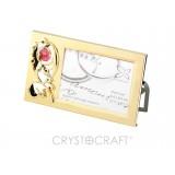 Fotorāmītis ar SWAROVSKI kristāliem, zelta pārklājums. Izmērs 13,9 x 8,2 cm.  Fotogrāfijas izmērs: 6,4*8,9.