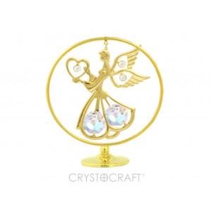 Eņģelis ar sirdi rokās aplī, ar SWAROVSKI kristāliem, uz pamatnes, zelta pārklājums. Izmērs 5 x 9 cm.