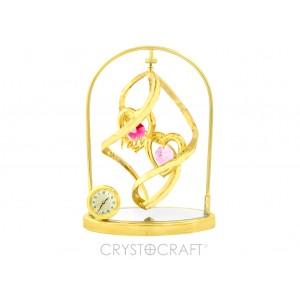 Sirdis spirāļvirpulī  uz spoguļpamatnes ar pulksteni, ar SWAROVSKI kristāliem, zelta pārklājums. Izmērs 10 x 4,5 x 13,5 cm.