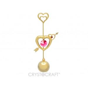 Sirdis ar bultu, ar SWAROVSKI kristāliem, uz lodveida pamatnes, zelta pārklājums. Izmērs 6 x 11 cm.