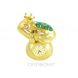 Vardīte uz pamatnes ar pulksteni, ar SWAROVSKI kristāliem, zelta pārklājums. Izmērs 7 x 5 x 8 cm.