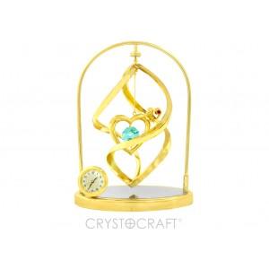 .Pulksteņi ar sirds sprālvirpulī uz spoguļpamatnes, ar SWAROVSKI kristāliem, zelta pārklājums. Izmērs 10 x 4,5 x 13,5 cm.