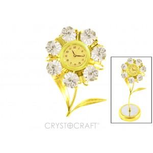 Zieds ar pulksteni ar SWAROVSKI kristāliem, uz pamatnes, zelta pārklājums. Izmērs 6x6x15 cm.