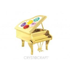 Klavieres ar SWAROVSKI kristāliem, zelta pārklajums. Izmērs 8 x 6 x 10 cm.