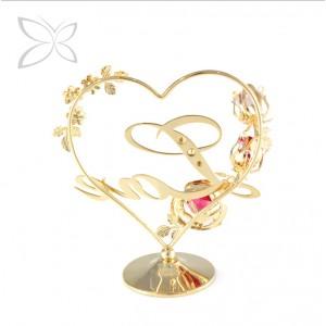 """Uzraksts """"Love"""" sirds formā ar puķēm, ar SWAROVSKI kristāliem, zelta pārklājums. Izmērs 11,5 х 12,2 cm."""